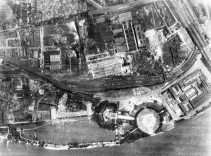 Vertical photographic-reconnaissance aerial taken over Cologne, Germany after Operation MILLENNIUM, the first 'Thousand-bomber' raid by aircraft of Bomber Command on the night of 30/31 May 1942. This shows the partially-destroyed exhibition hall (Osthalle) and railway sidings in Koln-Deutz. C 2549 Part of AIR MINISTRY SECOND WORLD WAR OFFICIAL COLLECTION No. 1 PRU