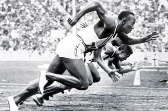 1936 Olympic Games, Berlin, Germany, Men's 100 Metres Final, USA's legendary Jesse Owens on his way to winning one of his four gold medals (Photo by Popperfoto/Getty Images)