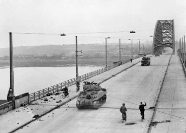 british_xxx_corps_cross_the_road_bridge_at_nijmegen