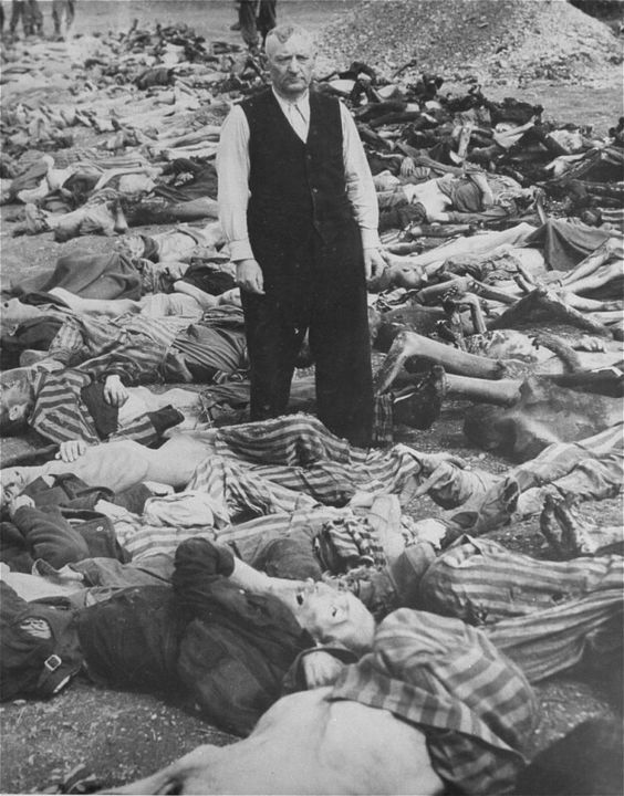 ss-officer-johann-baptist-eichelsdoerfer-the-commandant-of-the-kaufering-iv-concentration-camp-hurlach-bavaria-germany-stands-among-the-corpses-of-prisoners-killed-in-his-camp-dat