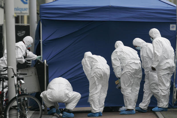 Police forensic experts search for clues