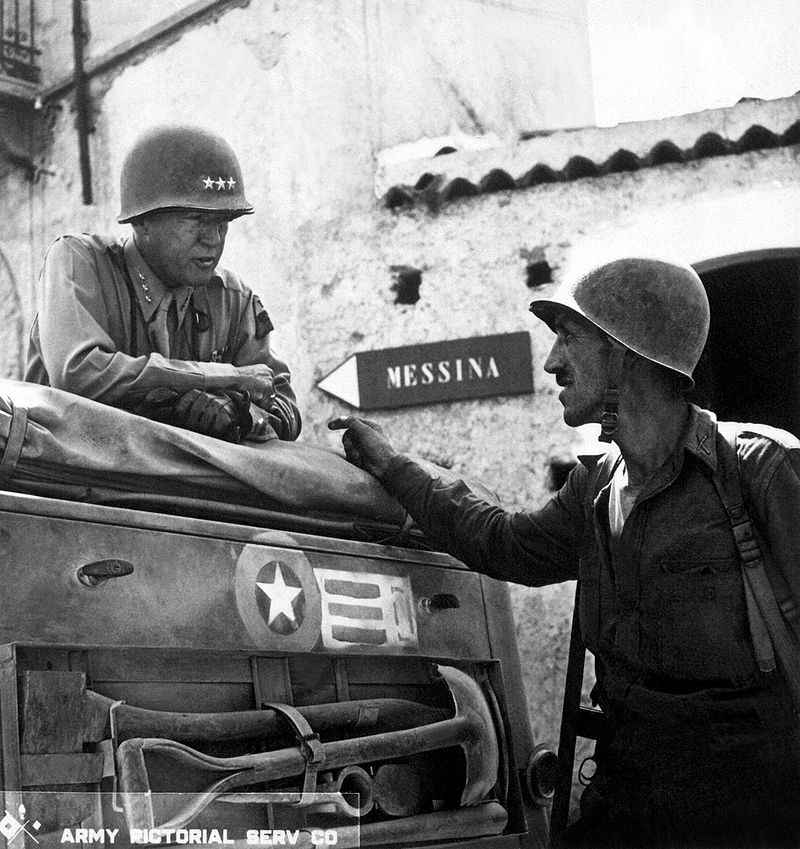 800px-patton_speaking_with_lt-_col-_lyle_bernard_at_brolo_circa_1943