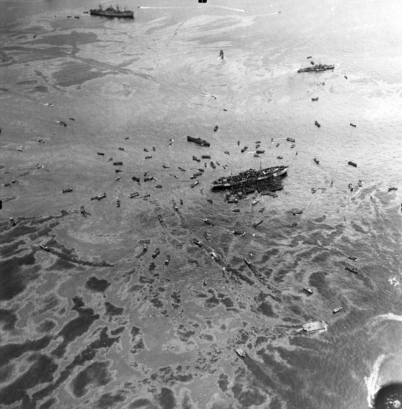 aerial_view_of_uss_mindanao_arg-3_after_the_explosion_of_uss_mount_hood_ae-11_at_seeadler_harbor_on_10_november_1944