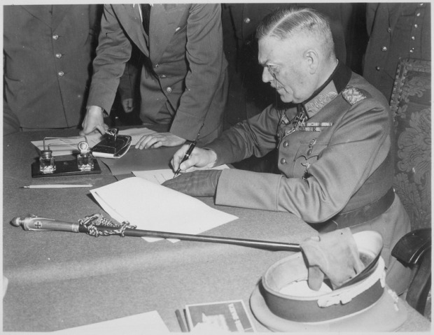 field_marshall_wilhelm_keitel_signing_the_ratified_surrender_terms_for_the_german_army_at_russian_headquarters_in-_-_nara_-_531290-tif