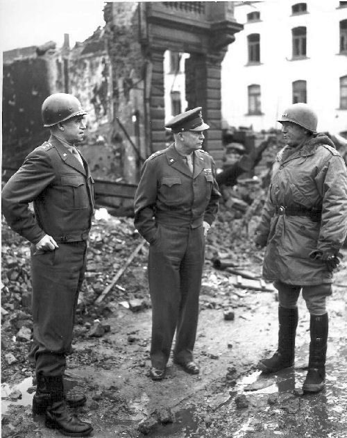 general_omar_bradley_general_dwight_eisenhower_and_general_george_patton_all_graduates_of_west_point_survey_war_damage_in_bastogne_belgium-_1944-1945