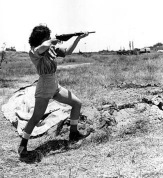 A female officer in charge of the range at the Hen women's corps camp near Tel Aviv, Palestine, gives a demonstration in the handling of a Sten gun on June 15, 1948 in the Arab-Israeli War. Although non-combatants, members the new women's Army in Israel are taught to use guns for defense. (AP Photo)