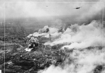 Operation OYSTER, the daylight attack on the Philips radio and valve works at Eindhoven, Holland, by No. 2 Group. Douglas Bostons fly over the burning Emmasingel lamp and valve factory at the height of the raid. The works were so severely hit that full production was not resumed for six months. C 5755 Part of AIR MINISTRY SECOND WORLD WAR OFFICIAL COLLECTION No. 2 Group RAF