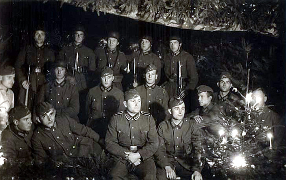 german-soldiers-gathered-around-a-glowing-christmas-tree-on-early-world-war-ii-christmas-eve