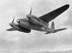 Mosquito B Mark IV Series 2, DK338, in flight after completion. DK338 served with No. 105 Squadron RAF as 'GB-O', and took part in the successful low-level raid on the Phillips radio factory at Eindhoven, Holland, (Operation OYSTER) on 6 December 1942, led by the Squadron Commander, Wing Commander H.I.Edwards VC. CH 7781 Part of AIR MINISTRY SECOND WORLD WAR OFFICIAL COLLECTION De Havilland photographer for Ministry of Aircraft Production