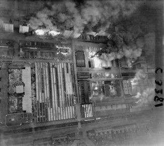 Operation OYSTER, the daylight attack on the Philips radio and valve works at Eindhoven, Holland, by No. 2 Group. Low-level photographic-reconnaissance aerial taken over the Stryp Group main plant 30 minutes after the attack, showing extensive damage to the radio assembly shop and fires still burning at several points. Full production of electrical material at the factory was not reached again until 6 months after the raid. The bombers suffered a loss rate of 15 per cent for the whole force. C 3281 Part of AIR MINISTRY SECOND WORLD WAR OFFICIAL COLLECTION No. 139 Squadron RAF