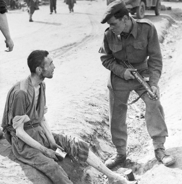 a-british-soldier-listens-to-the-story-of-an-inmate-of-the-horror-camp-at-belsen