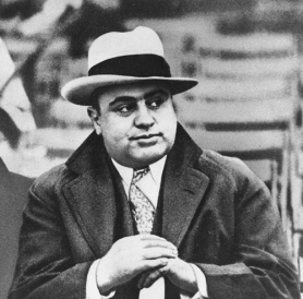 **ADVANCE FOR SUNDAY, JAN. 28 - FILE** Chicago mobster Al Capone is seen at a football game in Chicago on Jan. 19, 1931. Sixty years after Capone's death, the world's most famous gangster still draws a crowd in Chicago and visitors from all over the world come to search for anything Capone, who died Jan. 25, 1947. (AP Photo/File)