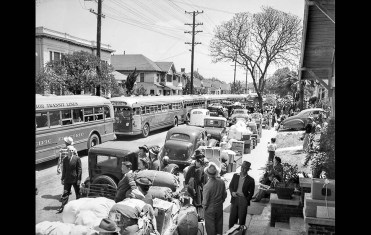 Apr. 30, 1942: Busses line street at 23rd St. and Vermont Ave. waiting for group of 600 Japanese to be moved to the temporary internship camp at Santa Anita Race Track. This photo was published in the May 1, 1942, Los Angeles Times.
