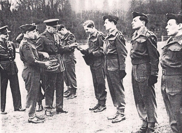 Lieut General Sir D J Bernard presenting shamrock to 2 RUR St Patricks Day 1944