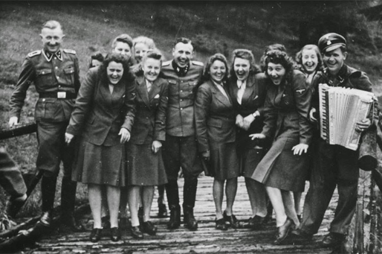 SS-auxiliaries-poses-at-a-resort-for-Auschwitz-personnel.-From-laughing-at-Auschwitz-c.-1942