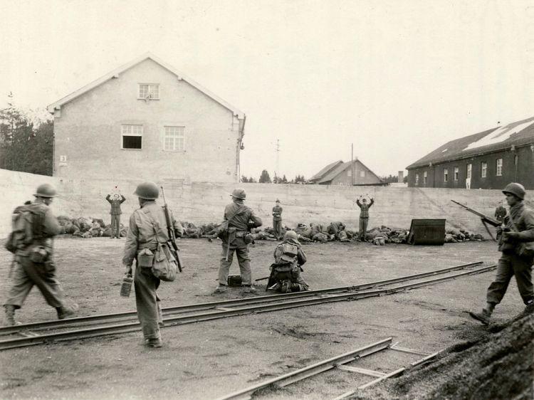 1024px-Dachau_execution_coalyard_1945-04-29