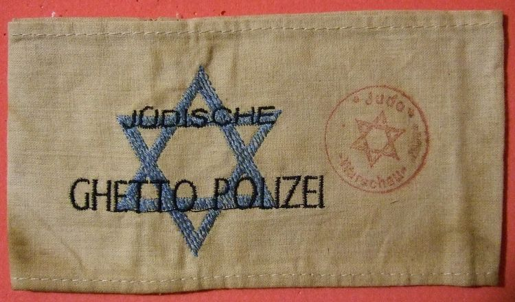 1280px-Jewish_Warsaw_Ghetto_Police_Arm_Band_early_1940s