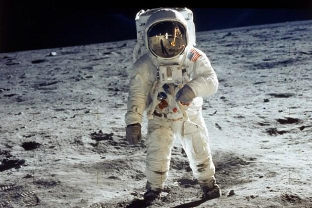 Apollo 11 astronaut Buzz Aldrin standing on moon,