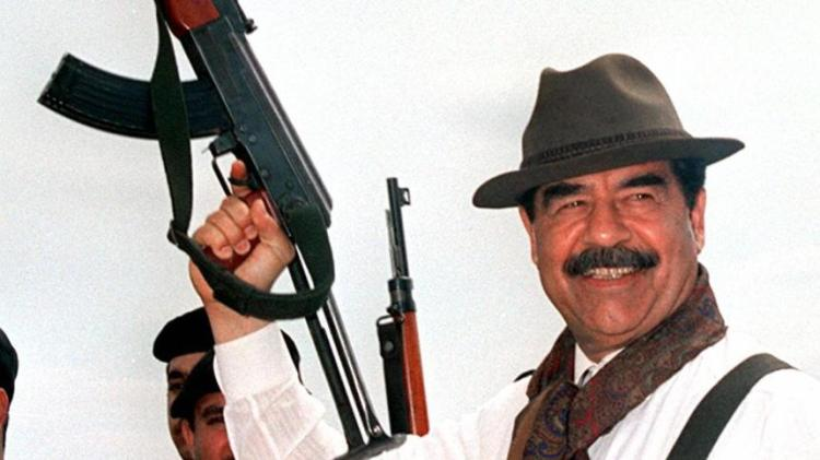 saddam machine gun