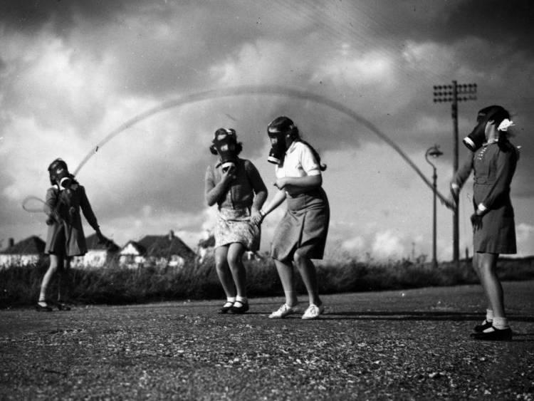 girls-wearing-gas-masks-playing