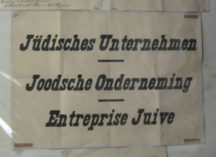 1024px-Poster_denoting_Jewish-owned_business_from_occupied_Belgium