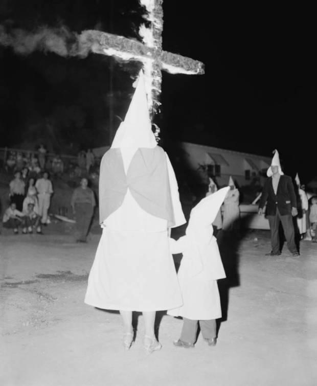 child-watches-cross-burning