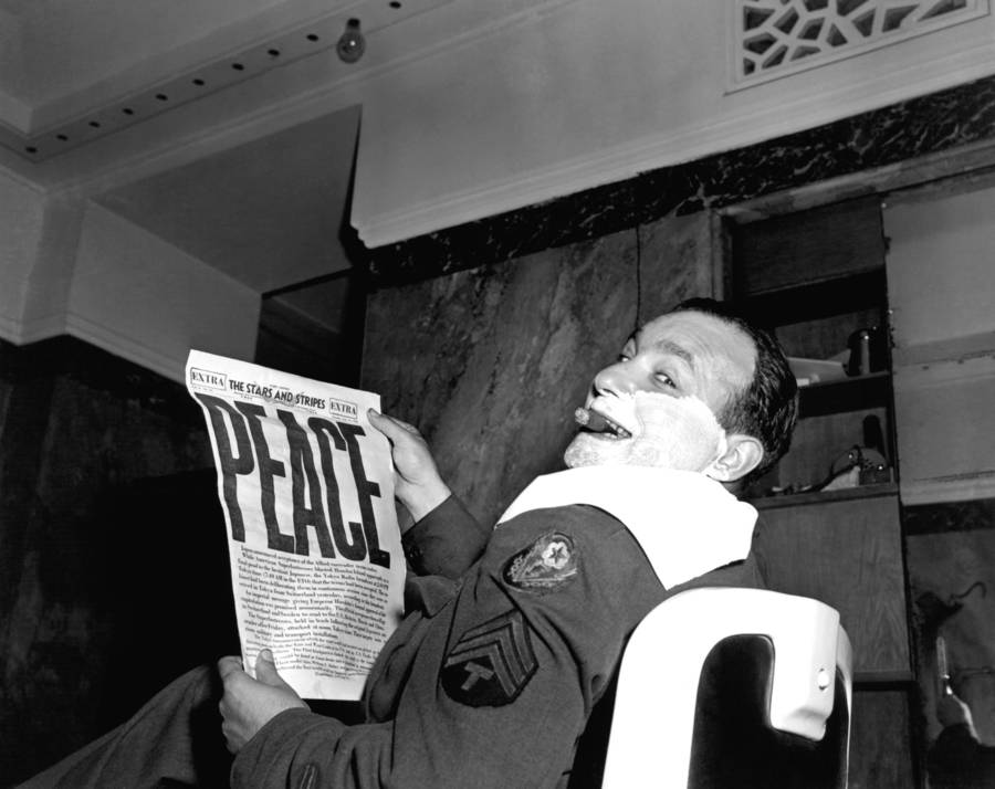 man-shaving-reading-newspaper