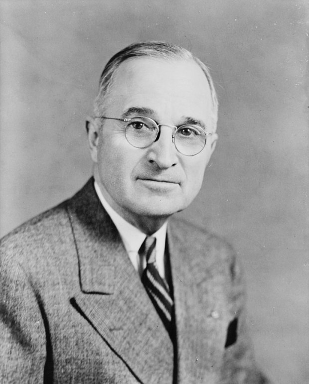 723px-Harry_S_Truman,_bw_half-length_photo_portrait,_facing_front,_1945.jpg