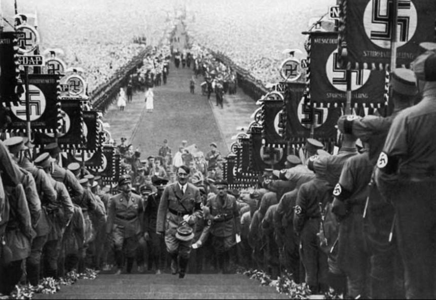 hitler-walking-up-steps-at-nazi-rally-860x593