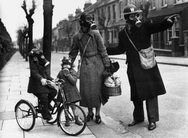 A-warden-gives-directions-to-a-mother-and-her-two-children-during-a-World-War-II-gas-drill-in-Southend-on-Marcy-29-1941.-Eric-HarlowKeystoneGetty-Images