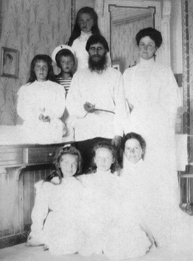 Empress Alexandra Feodorovna with Rasputin, her children and a governess.