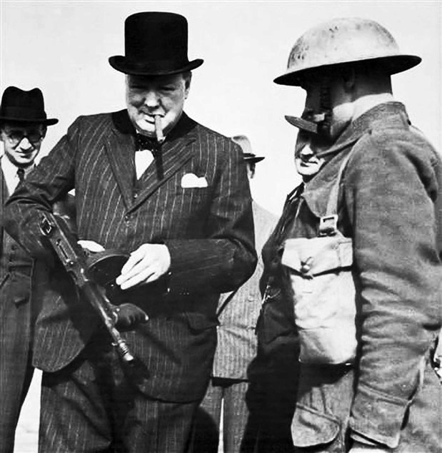 Winston Churchill with a Tommy Gun during an inspection near Harlepool, 1940