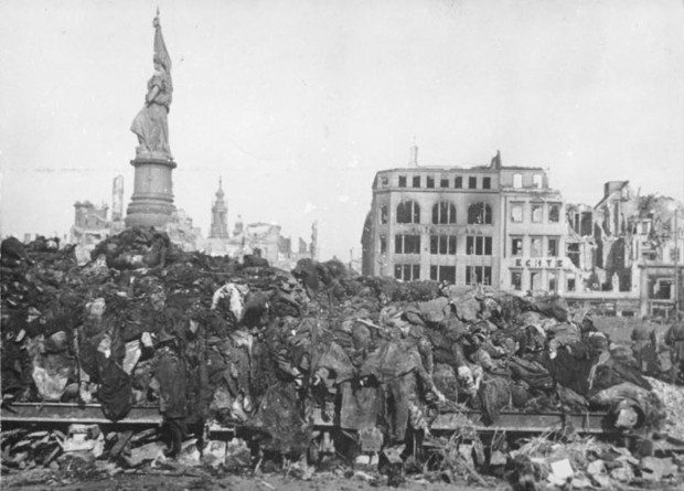 A pile of bodies awaits cremation after the firebombing of Dresden, February 1945.jpg