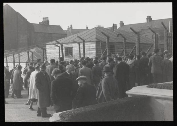 Photograph of internees in a yard at Hutchinson Internment Camp [c.1940-1] by Major H. O. Daniels