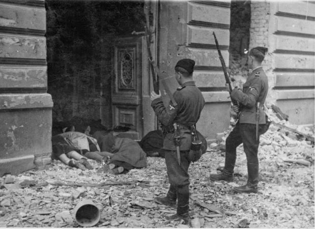Ukrainian askaris standing near bodies of murdered Jews, Warsaw, 1943