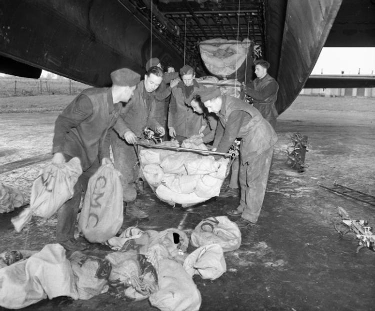 Loading_Lancaster_at_RAF_Waterbeach_for_Operation_Manna_1945_IWM_CH_15159