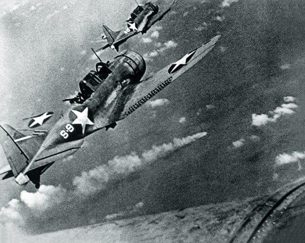 1024px-SBD-3_Dauntless_bombers_of_VS-8_over_the_burning_Japanese_cruiser_Mikuma_on_6_June_1942