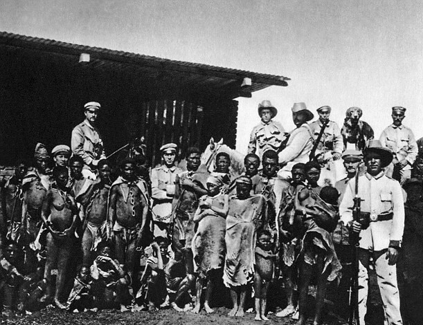 364CE51100000578-3691589-German_troops_pose_for_a_photo_with_tribe_members_during_the_gen-a-22_1468572118970